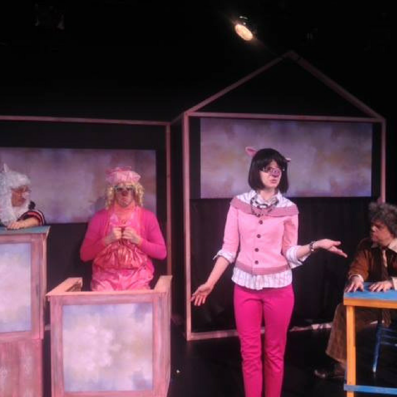 A new imagining of the story of the 3 little pigs in a children's theater production