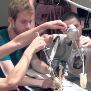 students operate the puppet from Linthead during onsite artistic residencies